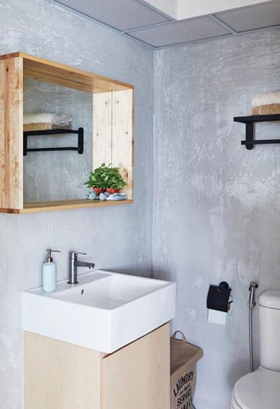 WC cũng có tường màu xi măng để phù hợp với các phòng khác trong nhà.